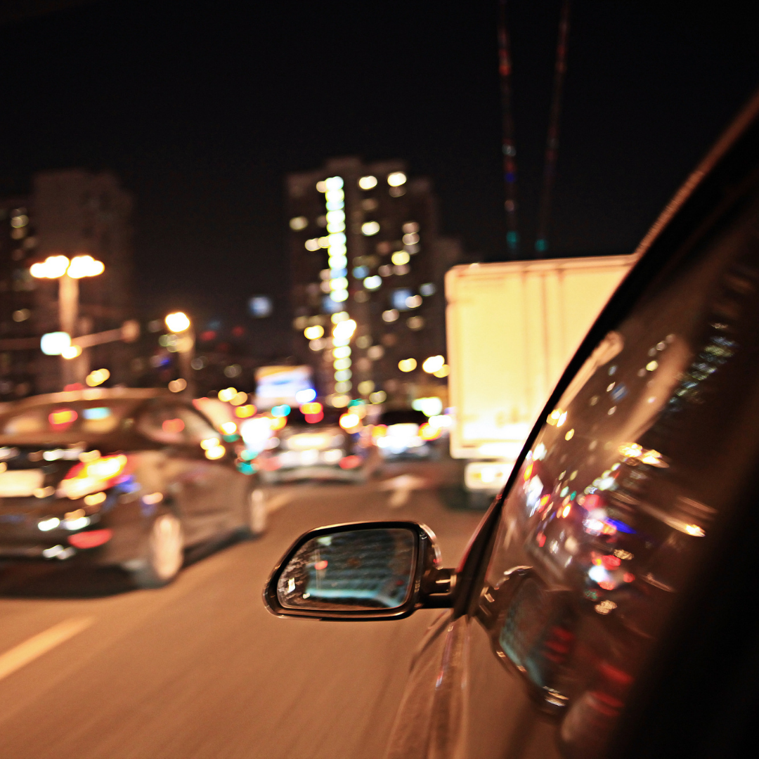 image of car side mirror at night